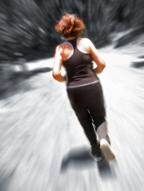 Image of middle-aged woman running
