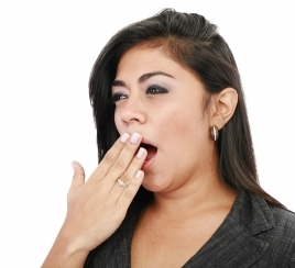 Image of middle-aged woman yawning