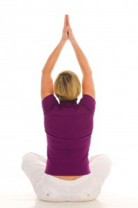 Image of middle-aged woman in yoga pose